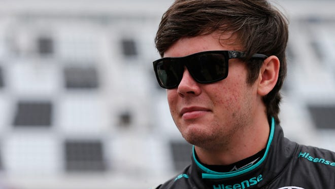 Erik Jones, driver of the #20 Hisense Toyota, stands on the grid during qualifying for the NASCAR XFINITY Series PowerShares QQQ 300 at Daytona International Speedway on February 25, 2017 in Daytona Beach, Florida.