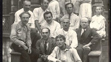 In this 1921 photo provided by the American Jewish Joint Distribution Committee (JDC), the painter Marc Chagall, front, poses with other teachers and children sitting behind him on the steps outside the JDC-run Jewish School-Camp for War Orphans near Moscow. Years later, in 1941, through JDC?s efforts, Chagall and his wife Bella escaped war-torn Europe aboard the SS Mouzhino that carried 798 other passengers from Lisbon, Portugal, to the United States. The JDC, a 100-year-old humanitarian assistance organization that helps Jews and non-Jews around the world, is the focus of a New York City exhibition ?I Live. Send Help,? which will include the photo.
