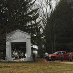Workers finish the installation of a memorial honoring the late Malcom Glazer on March 10, 2016, at Mt. Hope Cemetery.