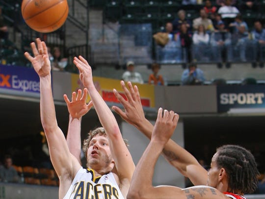 Travis Diener (12), shown against the Bulls in 2008, saw his playing time decrease each year with the Pacers.