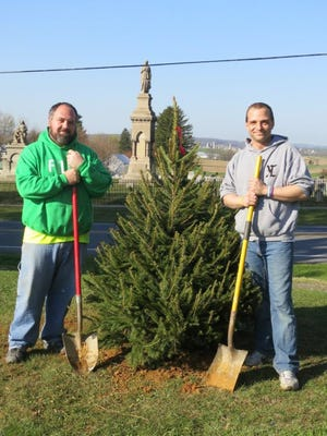 For the second consecutive year, Kountry Kraft, Newmanstown, has planted a Norway Spruce tree at White Swan Park on North Sheridan Road to commemorate Arbor Day. Pictured are Kountry Kraft employees Jamie Highley, left, and Wade Putt.