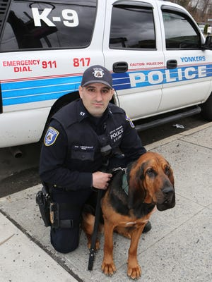 Yonkers Police Officer Robert Ascolillo and his K-9 partner, Cali, a 2-year old bloodhound, are pictured outside of the Emergency Services Unit in Yonkers.