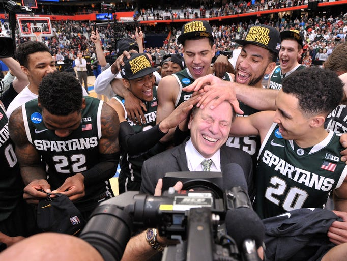 The Spartans mess up Tom Izzo's hair in celebration