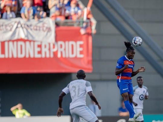 FC Cincinnati midfielder Michael Lahoud heads the ball during the USL soccer match between Minnesota United and FC Cincinnati, Wednesday, June 6, 2018, at Nippert Stadium in Cincinnati.