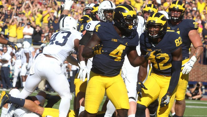 Michigan #4 De'Veon Smith celebrates after scoring during first half action.