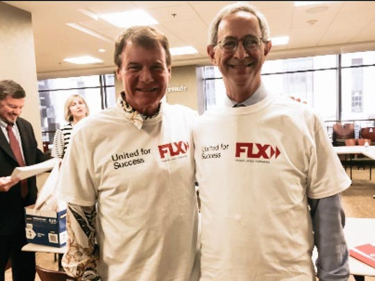 Danny Wegman and Joel Seligman wore T-shirts touting the Finger Lakes Regional Economic Development Council's plan to secure $500 million from the state.