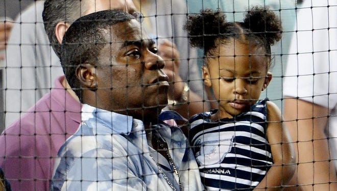 Comedian Tracy Morgan holds his daughter Maven Sonae during a game between the Boston Red Sox and the New York Yankees in New York, Aug.4, 2015.
