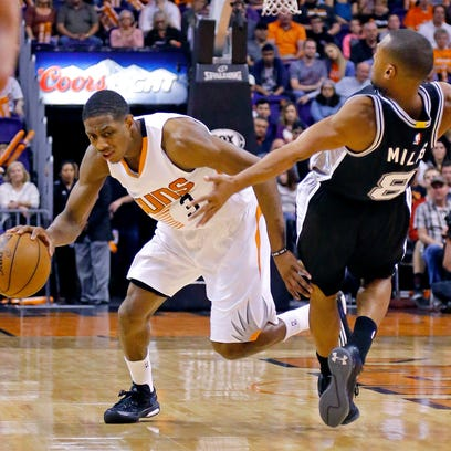 San Antonio Spurs guard Patty Mills (8) is called for