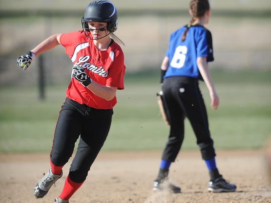 Lomira's Lauren Luedtke rounds second base during a game against St. Mary's Springs in April.