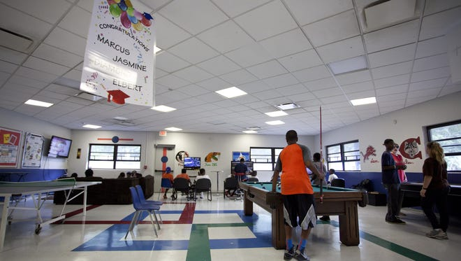 Teens play pool and video games at the Palmer Munroe Teen Center in 2013.