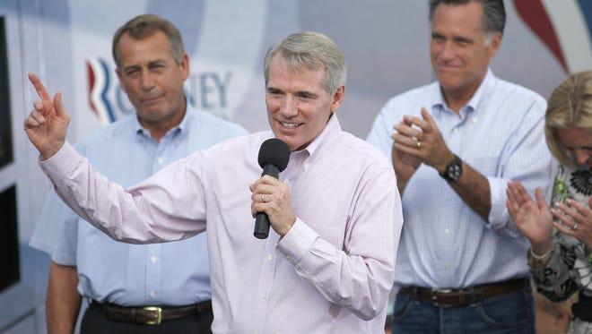 U.S. Sen. Rob Portman, R-Terrace Park, speaks on behalf of Republican presidential candidate Mitt Romney as U.S. House Speaker John Boehner, R-West Chester, listens in Troy on Sunday.
