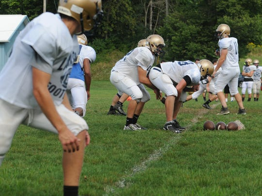 The Lancaster football team lines up to run a play during Monday's practice.