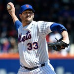 New York Mets starter Matt Harvey pitches against the Miami Marlins in the first inning at Citi Field on Sunday.