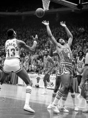 Wilt Chamberlain (13) and Wes Unseld (41) reach for a rebound during the 1973 NBA All-Star Game that was played at Chicago Stadium on Jan. 23, 1973.