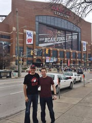 Green Bay-area friends Logan Krueger, left, and Chett Zeise stand outside Lucas Oil Stadium in Indianapolis on Friday afternoon, April 3. The NCAA men's basketball Final Four, which includes the Wisconsin Badgers, will be played at the stadium Saturday. Krueger is a graduate of Denmark High School, and Zeise is an alum of Green Bay Notre Dame.