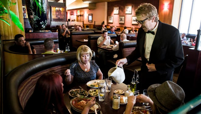 Waiter Christopher Landon, 46, works a shift at Original Joe's restaurant in San Jose on June, 2.  Landon has worked there for 15 years.