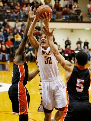 Haden Deaton with a shot against Warsaw in the Class 4A Semistate Saturday, March 19, 2016, at Lafayette Jeff High School. McCutcheon defeated Warsaw 40-37 to advance to the state finals.