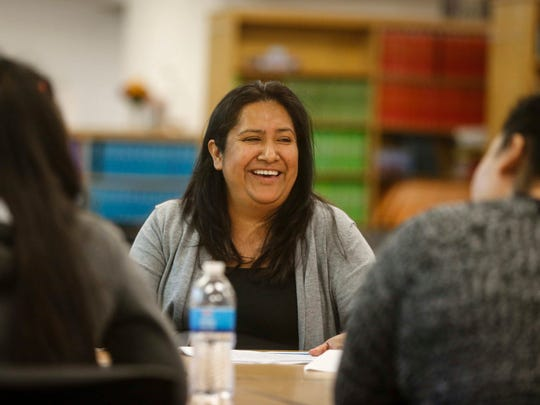 Isabel Conn speaks with immigrant families during a program on April 11, 2017, at North High School in Des Moines. The Des Moines district has among the highest portions of foreign-born students in the state. Students in the district speak 120 languages.