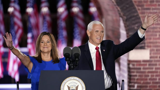 Vice President Mike Pence arrives with his wife Karen Pence to speak on the third day of the Republican National Convention at Fort McHenry National Monument and Historic Shrine in Baltimore, Wednesday, Aug. 26, 2020.