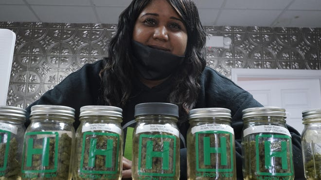 Teesha Montague works at Huron View Provisioning in Ann Arbor, Thursday, Jan. 28, 2021. Michigan concluded its first year of state-licensed recreational marijuana sales in December, but the state found the commercial marijuana industry has drastically failed to attract people of color.