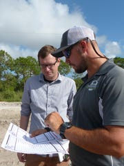 Reporter Thaddeus Mast chats with Farmer Mike's U Pick owner Mike Clevenger, Jr. about the maze.