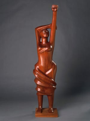 """Homage to Black Women Poets,"" 1984, Elizabeth Catlett, mahogany. Detroit Institute of Arts. From the exhibit titled, ""Art of Rebellion: Black Art of the Civil Rights Movement"" at the DIA July 23 - Oct. 22, 2017."