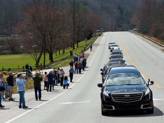 People line the streets of Swannanoa, N.C., to view