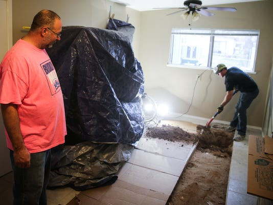 Volunteers work at Connie Motley's home
