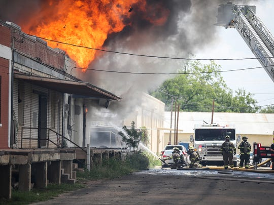 Firefighters battle a warehouse blaze Saturday, July