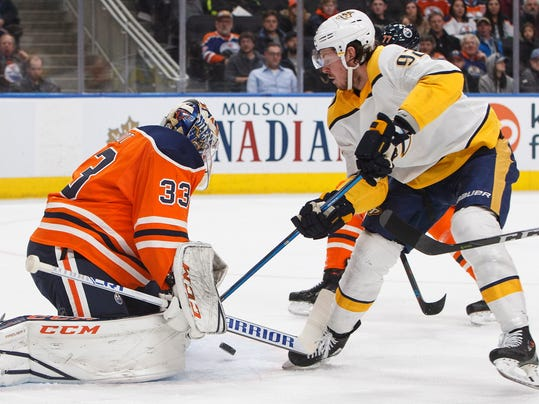 Nashville Predators' Ryan Johansen (92) is stopped by Edmonton Oilers goalie Cam Talbot (33) during the first period of an NHL hockey game Thursday, March 1, 2018, in Edmonton, Alberta. (Jason Franson/The Canadian Press via AP)