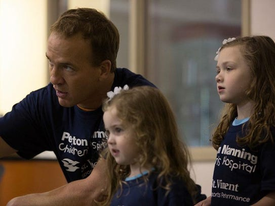 The Cooley sisters with Peyton Manning.