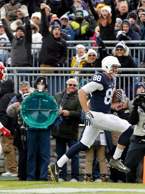 Penn State's Mike Gesicki (88) runs in for a touchdown after a catch against Rutgers during the second half of an NCAA college football game in State College, Pa., Saturday, Nov. 11, 2017. Penn State 35-6. (AP Photo/Chris Knight)