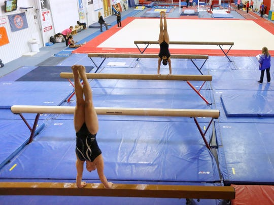 Timed handstands during physical verification tests at the Karolyi Ranch. Photo by Erich Schlegel/USA TODAY Sports Images