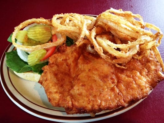 The Lucky Pig Pub & Grill in Ogden has the state's best breaded tenderloin sandwich according to the Iowa Pork Producers Association. Owners Craig and Carol Christensen provide the pork for the sandwiches from their farm near Ogden.