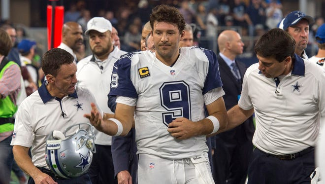 Cowboys QB Tony Romo is helped off the field Thursday after reinjuring his collarbone.