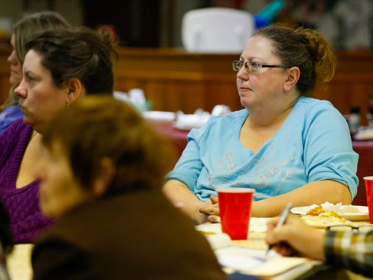 Demita Gookin listens to a presentation by Springfield School Board members at the Woodlawn Heights Neighborhood Association meeting on Friday, March 17, 2017.
