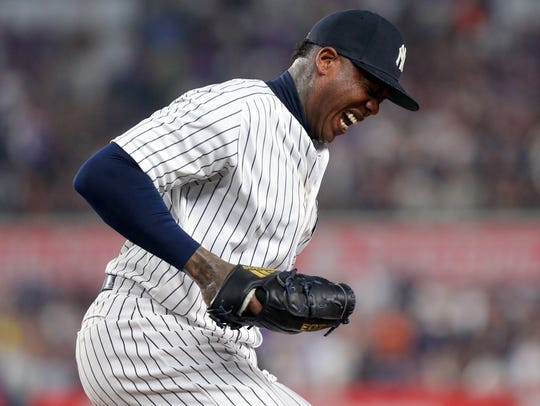 Yankees relief pitcher Aroldis Chapman grimaces as