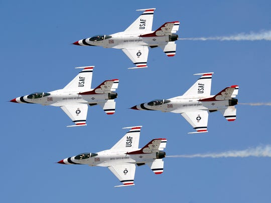 "The U.S. Air Force Thunderbirds perform the ""Diamond Pass and Review""  during a past show."