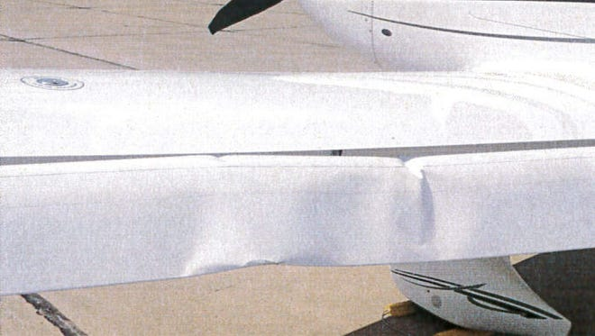 """A photo provided by the Bloomington Normal Airport Authority shows the damaged wing of a Cirrus SR22 single-engine plane at the Central Illinois Regional Airport in Bloomington. Iowa State University President Steven Leath caused """"substantial damage"""" to the university airplane he was piloting when it made a hard landing at the Illinois airport last year — a costly incident kept quiet for 14 months."""