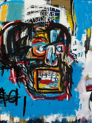 """""""Untitled,"""" Jean-Michel Basquiat's 1982 art piece, sold for a record $110.5 million at Sotheby's auction of contemporary art."""