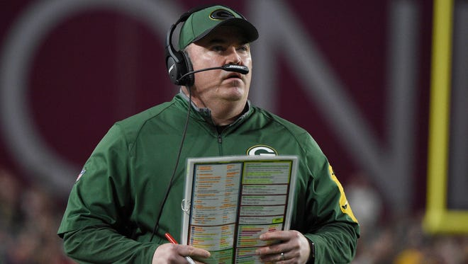 Green Bay Packers head coach Mike McCarthy watches game action against Arizona Cardinals during the first half in a NFC Divisional round playoff game at University of Phoenix Stadium.
