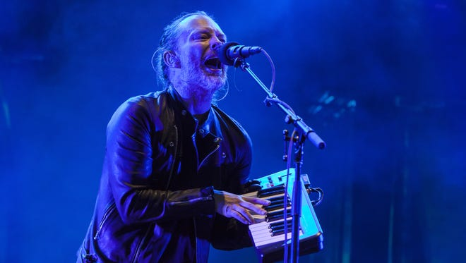 Radiohead's Thom Yorke plays during the British band's headlining set at Lollapalooza on Friday.