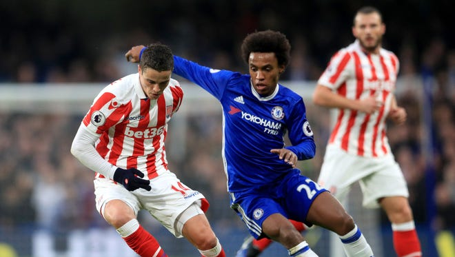 Stoke City's Ibrahim Afellay, left, and Chelsea's Willian battle for the ball during their match Saturday.