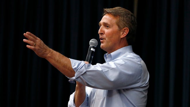 In this April 13, 2017, file photo, Arizona Republican Sen. Jeff Flake takes a question from the audience during a town hall in Mesa, Ariz.
