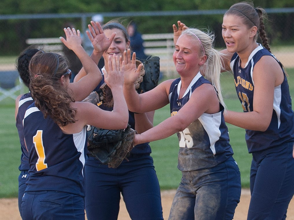 Gloucester High School's softball team congratulates Maddy Chain, center, after her win against Gloucester Catholic at West Deptford.