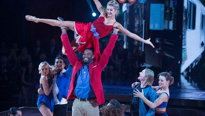 """Johnson's high-energy freestyle routine — a mashup of the Jackson 5's """"I Want You Back"""" and The Marvelettes' """"Please Mr. Postman"""" — incorporated dancing on a long treadmill and several flips and lifts (one of Johnson's strengths)."""