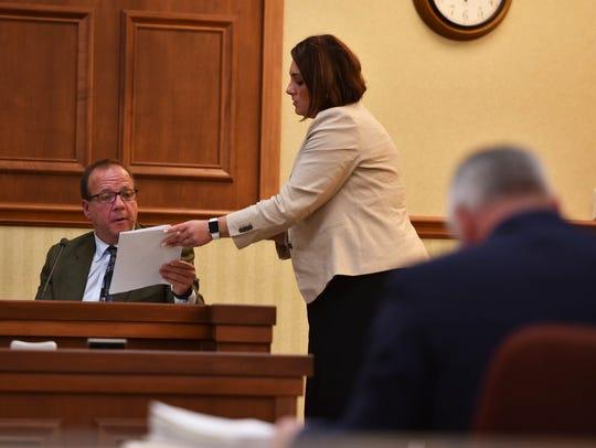 Brian M. Cooper's attorney, Ana Babcock, brings a transcript
