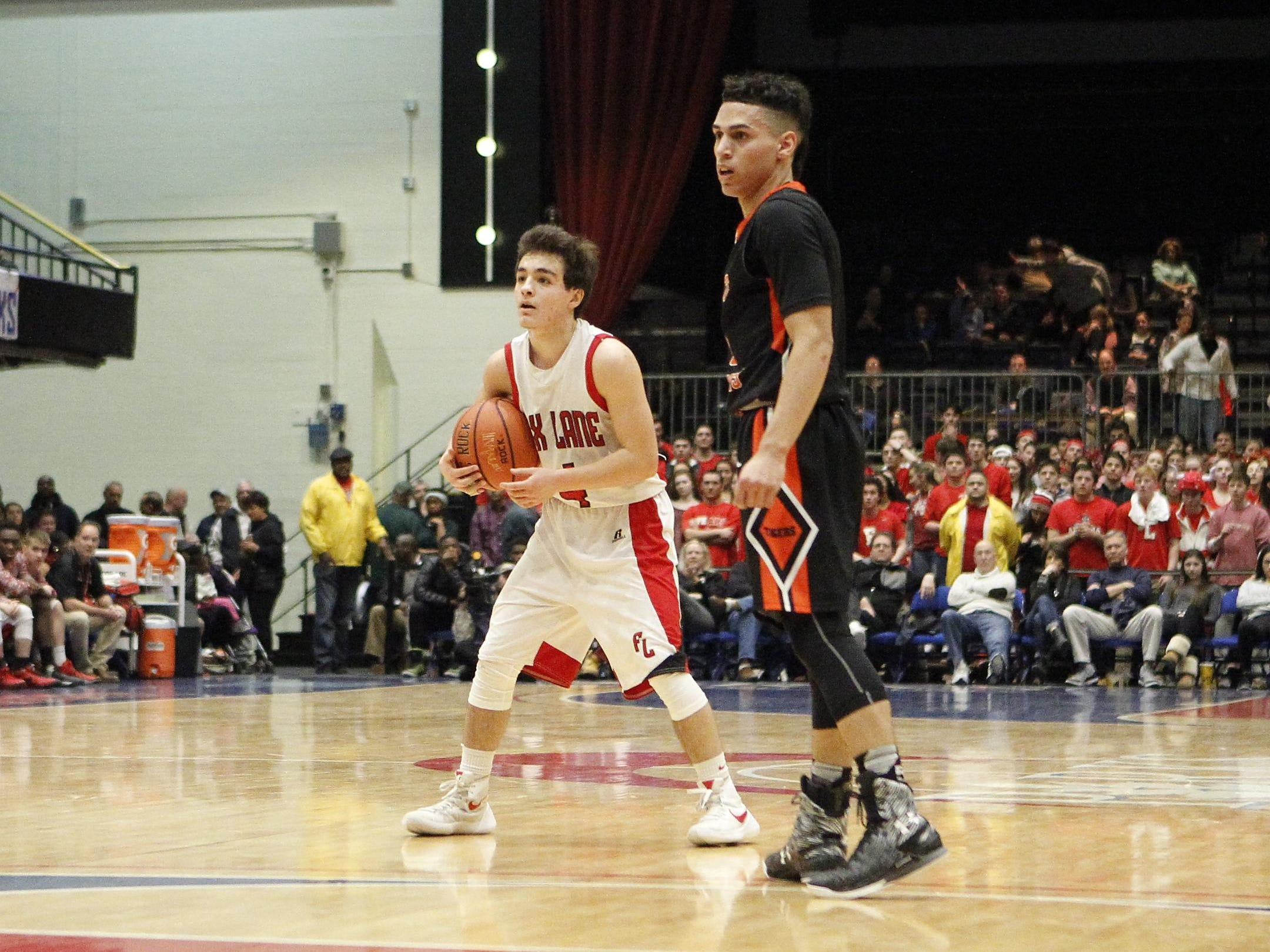 Fox Lane's Emmett Robin (4) holds possession during the boys Class AA semi-final basketball game against White Plains at the County Center in White Plains on Friday, February 26, 2016.