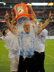 Former Titan Tim Shaw, who is battling ALS, takes the ice bucket challenge Aug. 28, 2014, at LP Field.