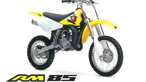 """A Suzuki RM 85, very similar to the one depicted in this image, was taken  recently in Dover Township, according to police. The dirt bike was yellow and black and had the word """"Breck"""" on the side panels and gold rims."""